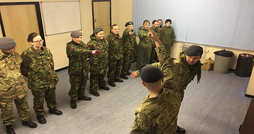 soldiers communicating hand signals
