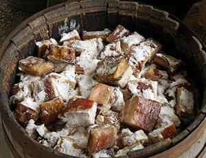 salting meat in a barrel