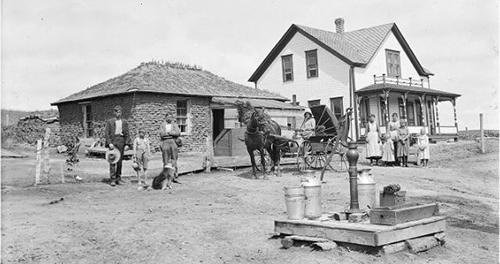Anton Smock homestead near Oconto, Custer County, Nebraska, 1904. Pictured, left to right, are: Alfonso Smock, Roy Smock, Anton Smock, Sophie, Mabel, Violet, Daisy, Rose, and Jenny. Photo by Solomon Butcher. Courtesy Nebraska State Historical Society