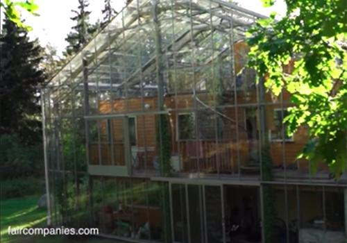 Couple Builds Greenhouse Around Home to Stay Warm and Grow Food All Year Long 1
