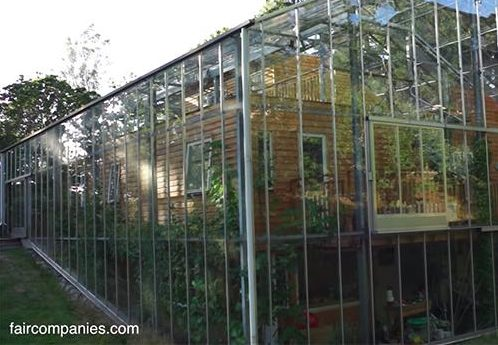 Couple Builds Greenhouse Around Home to Stay Warm and Grow Food All Year Long2
