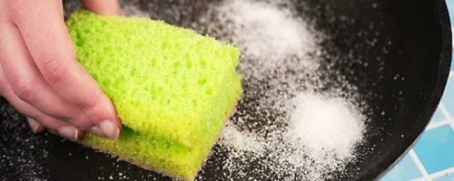 cleaning sponges in saltwater to sanitize them